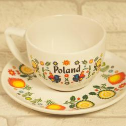 Filiżanka ze spodkiem folk z napisem Poland